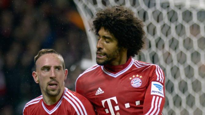 Bayern Munich's Ribery celebrates with Dante after scoring during their German Bundesliga first division soccer match against Werder Bremen in Bremen