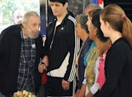 Fidel Castro (L) arrives to vote at a polling station in Havana in this photo from AIN, taken February 3, 2013. The ailing revolutionary leader expressed confidence in the revolution despite a decades-long US trade embargo