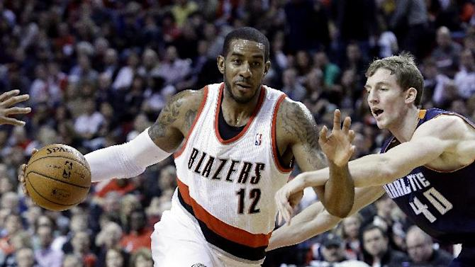 Portland Trail Blazers forward LaMarcus Aldridge, left, drives on Charlotte Bobcats center Cody Zeller during the second half of an NBA basketball game in Portland, Ore., Thursday, Jan. 2, 2014.  Aldridge scored 10 points and pulled in 15 rebounds as they beat the Bobcats 134-104