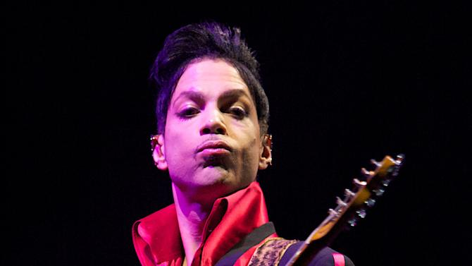 FILE - In this Nov. 14, 2010 file photo, Musician Prince performs in Yas Island, on the final night of the F1 motor race meeting in Abu Dhabi, United Arab Emirates. Prince will perform and be honored with Icon Award at the 2013 Billboard Music Awards. ABC announced on Friday, Jan. 18, 2013, that the 2013 Billboard Music Awards are set to return to ABC and will be broadcast live from the MGM Grand Garden Arena in Las Vegas Sunday, May 19, 2013 (8:00-11:00 p.m. ET). (AP Photo/Nousha Salimi, File)