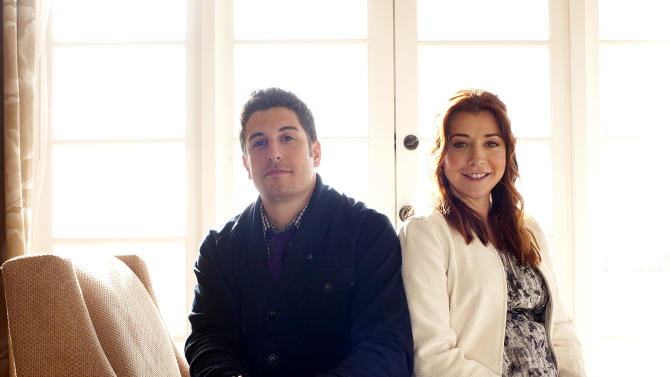 "In this March 18, 2012 photo, actors Jason Biggs, left, and Alyson Hannigan pose for a portrait during a media day for the upcoming feature film ""American Reunion"" in Los Angeles.  The film opens nationwide on Friday, April 6. (AP Photo/Dan Steinberg)"