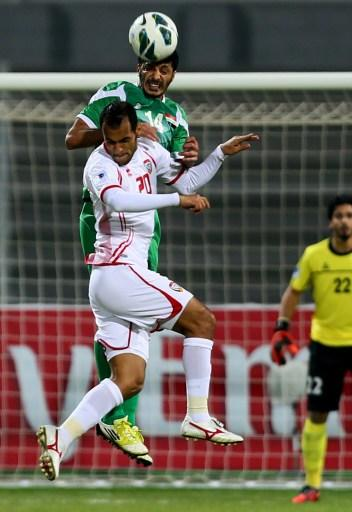 Salam Shakir (top) of Iraq vies with Ali Salem of UAE during the 21st Gulf Cup's final between United Arab Emirates (UAE) and Iraq on January 18, 2013 in Manama. United Arab Emirates won 2-1 against