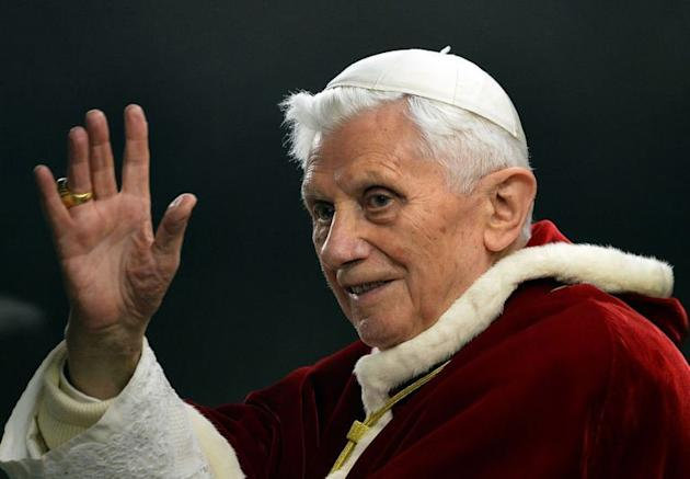 Pope Benedict XVI waves to worshippers as he arrives at St. Peter's Square on December 29, 2012. The pontiff say he will resign on February 28 because his age prevented him from carrying out his duties, an unprecedented move in the modern history of the Catholic Church