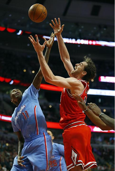 Los Angeles Clippers guard Jamal Crawford (11) and Chicago Bulls forward Pau Gasol (16) reach for the rebound during the second half of an NBA basketball game in Chicago, on Sunday, March 1, 2015. The