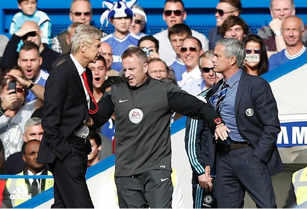 "Despite their rivalry and a scuffle last season, pictured, Chelsea manager Jose Mourinho (R) believes manager Arsene Wenger's (L) Arsenal are ""more than ready"" to challenge for the title"