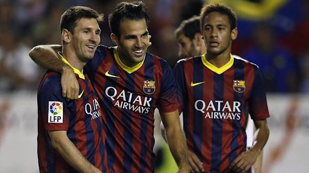 Barcelona's Cesc Fabregas (C) celebrates his goal against Rayo Vallecano with teammates Neymar (R) and Lionel Messi during their Spanish first division soccer match at Vallecas stadium in Madrid September 21, 2013 (Reuters)