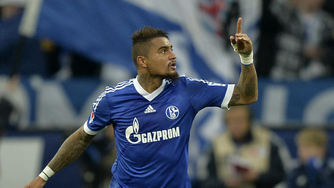 Schalke's Kevin-Prince Boateng  celebrates  after scoring during the German  Bundesliga soccer  match between FC Schalke 04 and Werder Bremen in Gelsenkirchen, Germany, Saturday, Nov. 9, 2013