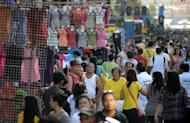 People can be seen shopping at Divisoria Market in Manila on October 29, 2012. The Philippines economy will likely grow more than government forecasts this year and pick up over the next two years, Economic Planning Secretary Arsenio Balisacan said Tuesday