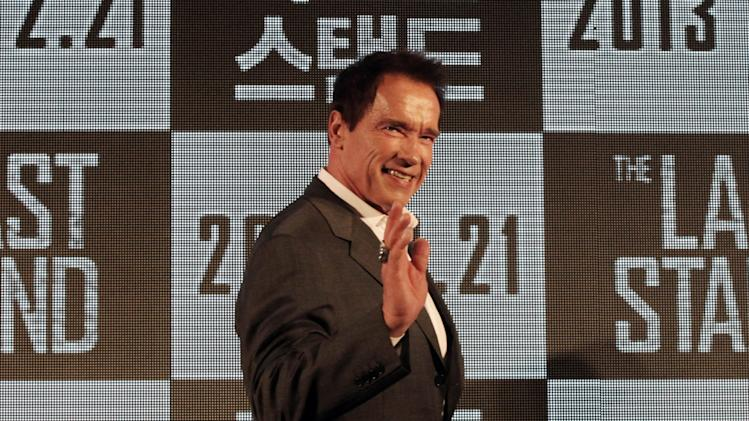"Actor Arnold Schwarzenegger waves as he arrives to hold a press conference to promote his latest film ""The Last Stand"" in Seoul, South Korea, Wednesday, Feb. 20, 2013. The movie will open on Thursday, Feb. 21, in South Korea.  (AP Photo Ahn Young-joon)"