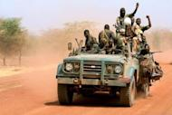 """Sudanese soldiers ride in a military vehicle in the oil region of Heglig in April 2012. South Sudan has not stopped hostilities in line with a UN resolution because it continues to """"occupy"""" points along the disputed border and will be expelled by force, Sudanese officials said Friday"""
