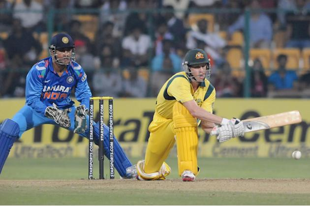Australian player James Faulkner plays a shot during the 7th ODI between India and Australia played at Chinnaswamy Stadium in Bangalore on Nov.2, 2013. (Photo: IANS)