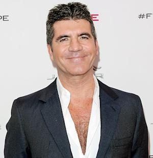 """Simon Cowell Gives First Interview Since Baby Eric's Birth, Says He """"Was Born to Be a Dad"""""""