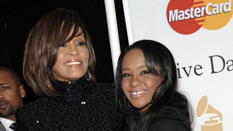 "FILE - In this Feb. 12, 2011 file photo, singer Whitney Houston, left, and her daughter Bobbi Kristina arrive at the Pre-Grammy Gala & Salute to Industry Icons with Clive Davis honoring David Geffen in Beverly Hills, Calif. A lawyer for Whitney Houston says her will is a ""straightforward"" case and he expects no complications. Houston's will was filed in probate court in Atlanta Wednesday. It revealed that the late superstar left all her assets to her only child, 19-year-old Bobbi Kristina. Her sister-in-law and manager, Pat Houston, was named as the administrator of the estate. (AP Photo/Dan Steinberg)"