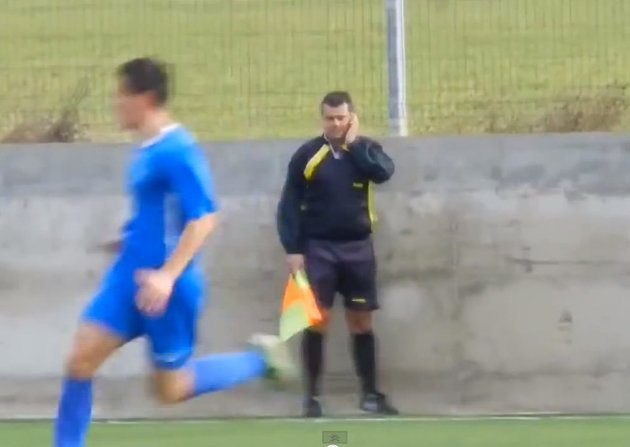 Bulgarian linesman uses his phone while officiating a match