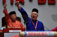 Malaysian Prime Minister Najib Razak (right) at the ruling party's annual general assembly in Kuala Lumpur in 2011. Activists have vowed to continue calls for electoral reform in Malaysia, with the protests coming at a precarious time for Razak's government as he is expected to call elections soon