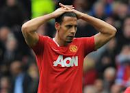 Manchester United defender Rio Ferdinand looks on ruefully after his side surrendered a 4-2 lead over Everton at Old Trafford on April 22, 2012. Manchester United manager Alex Ferguson has promised there will be no more shocks against Everton when David Moyes' team visit on Sunday