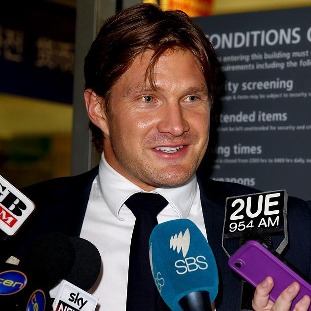 SYDNEY, AUSTRALIA - MARCH 12:  Shane Watson stops to answer questions from the media upon arrival at Sydney International Airport on March 12, 2013 in Sydney, Australia. Watson returned home after dis