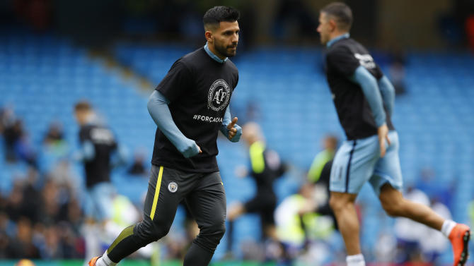 Manchester City's Sergio Aguero warms up with a shirt in relation to the victims of the Colombia plane crash containing the Chapecoense players and staff
