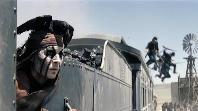 """This publicity image released by Disney shows Johnny Depp as Tonto in a scene from """"The Lone Ranger,"""" opening July 3, 2013. (AP Photo/Disney Enterprises, Inc. and Jerry Bruckheimer Inc.)"""