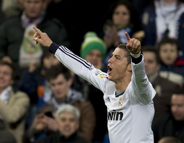 Real Madrid's Cristiano Ronaldo celebrates scoring against Sevilla at the Santiago Bernabeu on February 9, 2013. Ronaldo scored his 20th hat-trick as a Real Madrid player as the Spanish champions cruised to a 4-1 victory