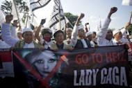 """Indonesian Islamic hardliners chant """"Go to hell, Lady Gaga"""" during a protest outside the US embassy on May 25 against the singer's scheduled Jakarta concert. Pop diva Gaga on Sunday cancelled her Indonesian concert with promoters saying the security threat was too serious after Islamic hardliners promised """"chaos"""" if she entered the Muslim nation"""