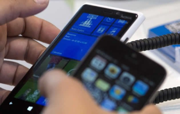 Microsoft has acquired Nokia in an effort to expand into smartphone market. (AFP Photo)