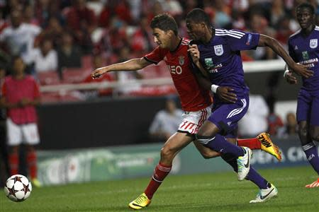 Benfica's Djuricic and Anderlecht's Mbemba fight for the ball during their Champions League soccer match at the Luz Stadium in Lisbon