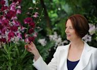 Australian Prime Minister Julia Gillard at the National Orchid Garden in Singapore on April 23. Gillard has defended her appointment of Peter Slipper as Australia's speaker as court documents alleged he used his position to pursue sexual relations with male employees