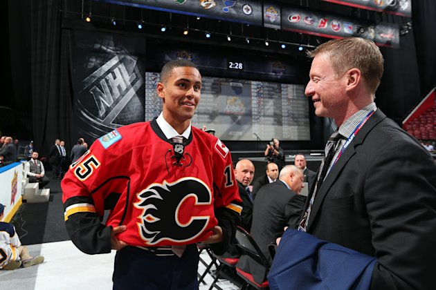 Oliver Kylington reacts after being selected 60th overall by the Calgary Flames during the 2015 NHL Draft.  (Photo by Bruce Bennett/Getty Images)