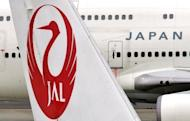 Japan Airlines marked a spectacular return from bankruptcy when its shares took off after relisting in Tokyo, three years after it became one of the nation's worst ever failures