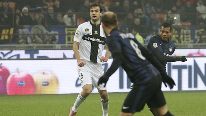 Inter Milan Colombian midfielder Fredy Guarin, right, scores a goal during the Serie A soccer match between Inter Milan and Parma at the San Siro stadium in Milan, Italy, Sunday, Dec. 8, 2013