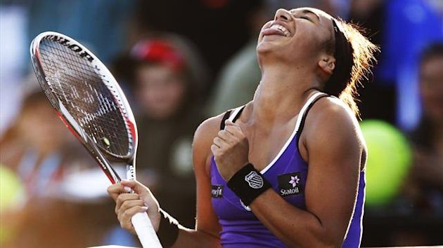 Heather Watson of Britain celebrates defeating Alexandra Cadantu of Romania in their women's singles match at the Australian Open tennis tournament in Melbourne (Reuters)