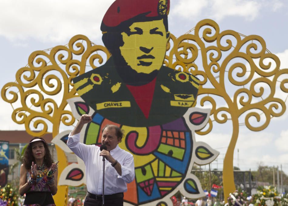 Nicaragua's President Daniel Ortega, accompanied by his wife, first lady Rosario Murillo, talks during an event to mark the first anniversary of the death of Venezuela's late president Hugo Ch