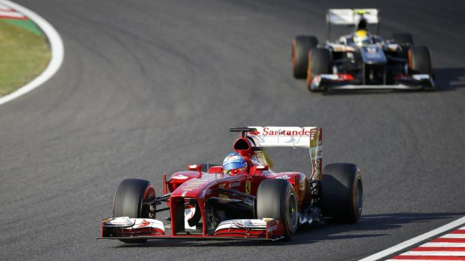 Ferrari Formula One driver Alonso of Spain races during the Japanese F1 Grand Prix at the Suzuka circuit