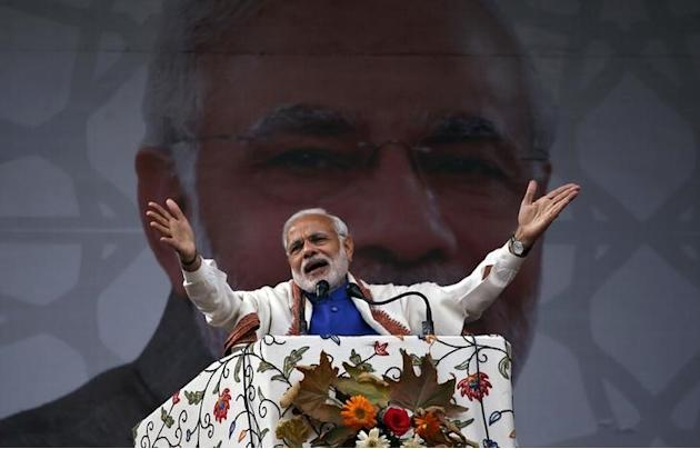 India's Prime Minister Narendra Modi addresses a rally in a cricket stadium in Srinagar,