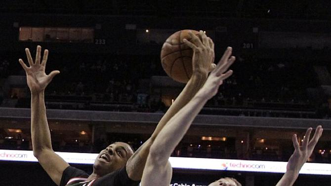 Milwaukee Bucks' John Henson, left, and Charlotte Bobcats' Cody Zeller, right, battle for a rebound during the first half of an NBA basketball game, Monday, Dec. 23, 2013, in Charlotte, N.C