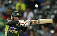 Pakistan's Nasir Jamshed plays a delivery by South Africa's Lonwabo Tsotsobe during their first Twenty20 cricket match in Johannesburg November 20, 2013. REUTERS/Siphiwe Sibeko/Files