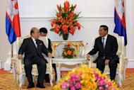 Cambodian Prime Minister Hun Sen (R) talks to North Korea's Foreign Minister Pak Ui-Chun (L) during a meeting in Phnom Penh. North Korea told Cambodia it is ready to rejoin stalled six-party denuclearisation talks, according to local sources, but there was no mention of whether it would agree to any pre-conditions first