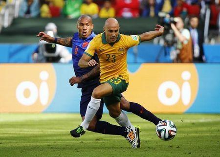 De Jong of the Netherlands fights for the ball with Australia's Bresciano during their 2014 World Cup Group B soccer match at the Beira Rio stadium in Porto Alegre