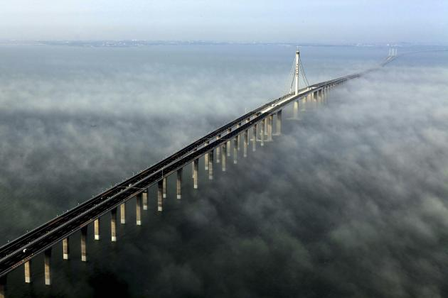 This photo taken Wednesday, June 29, 2011 released by China's Xinhua news agency shows the Jiaozhou Bay Bridge in Qingdao, east China's Shandong Province. China opened Thursday, June 30, 2011, the wor