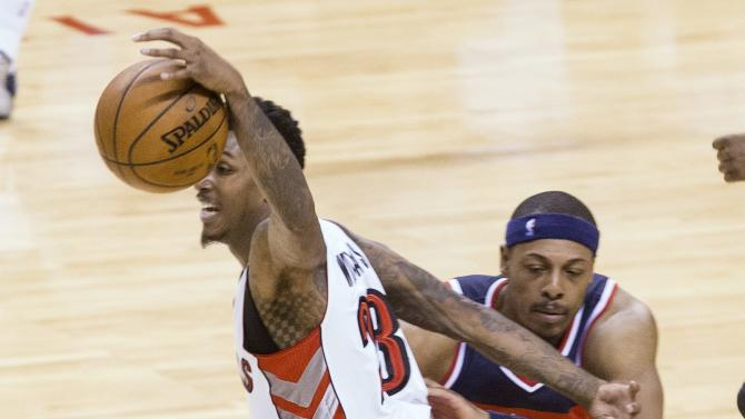 Toronto Raptors' Lou Williams is fouled on a breakaway by Washington Wizards' Paul Pierce during overtime in Game 1 in the first round of the NBA basketball playoffs, Saturday, April 18, 2015, in Toronto. The Wizards won 93-86 in overtime.  (Chris Young/The Canadian Press via AP)   MANDATORY CREDIT