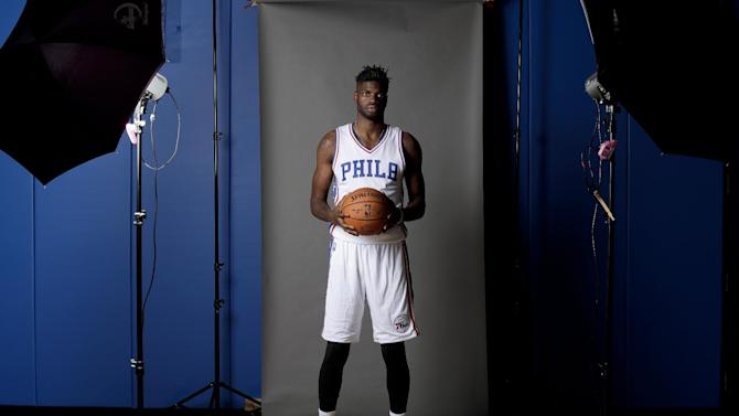 "Philadelphia 76ers center Nerlens Noel poses for a photograph during media day at the NBA basketball team's practice facility, Monday, Sept. 26, 2016, in Camden, N.J. Shortly after 76ers president and general manager Bryan Colangelo said he is not actively shopping any of his players, Noel openly wondered how he, Jahlil Okafor and Joel Embiid can co-exist as the team's three big men. ""I don't see a way of it working,"" Noel said Monday, one day before the Sixers' first full workout in their new practice facility along the New Jersey riverfront across from Philadelphia. ""It's just a logjam."" (AP Photo/Matt Slocum)"
