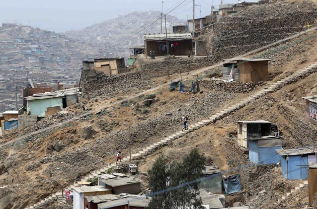 People climb stairs at Pamplona Alta shanty town in San Juan de Miraflores district of Lima
