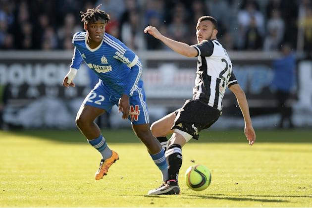 Marseille's forward Michy Batshuayi (L) vies with Angers' midfielder Romain Saiss during the French L1 football match on May 1, 2016 at the Jean Bouin stadium in Angers, France