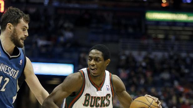 Milwaukee Bucks' Brandon Knight (11) drives to the basket against Minnesota Timberwolves' Kevin Love, left, during the second half of an NBA basketball game Saturday, Dec. 28, 2013, in Milwaukee