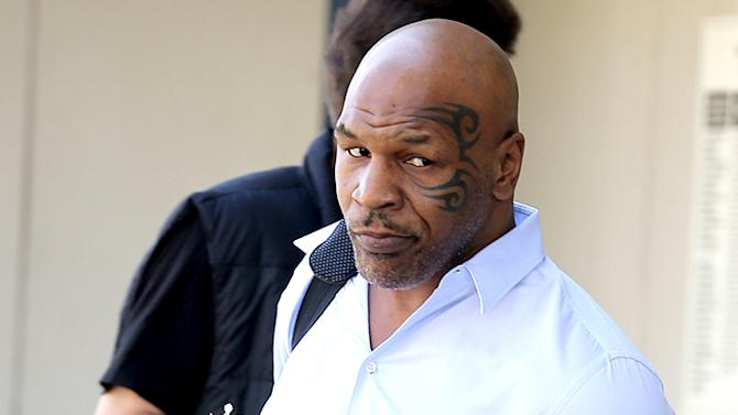 Mike Tyson and his wife spotted at LAX