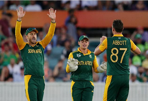 South Africa's Kyle Abbott, right, celebrates with teammates Francois Du Plessis, left, and Quinton De Kock after taking the wicket of Ireland's Gary Wilson during their Cricket World Cup Pool