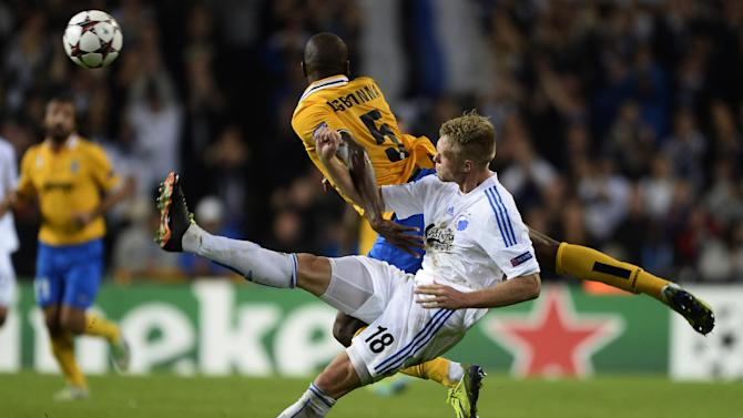 Juventus' Angelo Ogbonna and FC Copenhagen's Nicolai Jorgensen, foreground,  vie for the ball,  during their Champions League Group B soccer match at Parken Stadium, Copenhagen, Denmark, Tuesday Sept. 17, 2013
