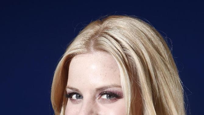"""File- In this Feb. 27, 2012 file photo, actress Megan Hilty poses for a portrait in New York. Hilty wrapped her second, and possibly final, season of the TV musical """"Smash."""" A day later, she sang to a sold-out house, marking her Carnegie Hall headlining debut. Since early this week, she's been racing around New York, getting the word out of her first solo album, """"It Happens All the Time,"""" which was released March 12, 2013.  (AP Photo/Carlo Allegri, File)"""