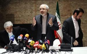 Iranian Foreign Minister Mohammad Javad Zarif and diplomats leave a news conference in Vienna